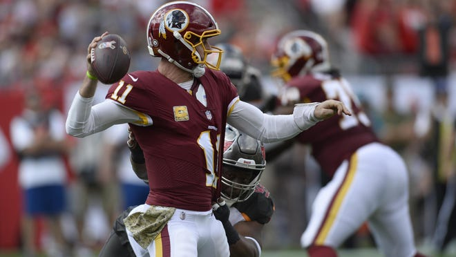 Washington quarterback Alex Smith (11) could be in the mix for the team's starting quarterback job.