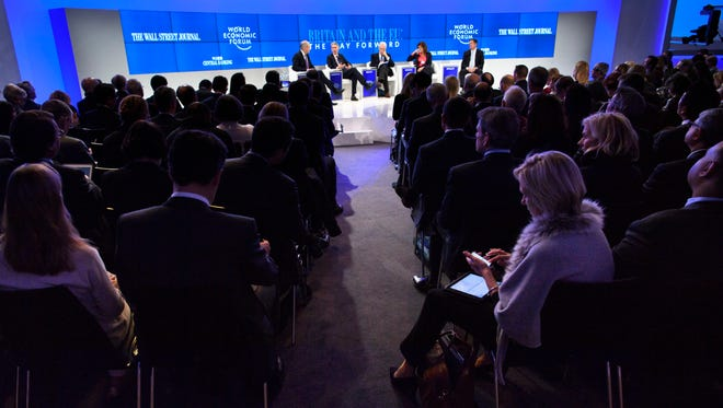 Participants listen a panel session during the closing day of the 47th annual meeting of the World Economic Forum, WEF, in Davos, Switzerland on Friday, Jan. 20, 2017.