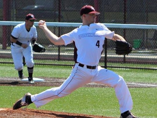 Earlham's Bryce Rainey throws a pitch during a game this season.