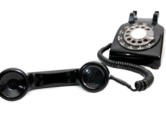 Classic Black Rotary Dial Telephone With Receiver in Focus