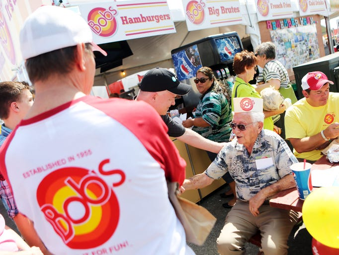 Bob Corey, 94 years young, celebrates the first day of the 149th-annual Oregon State Fair at his namesake burger stand.