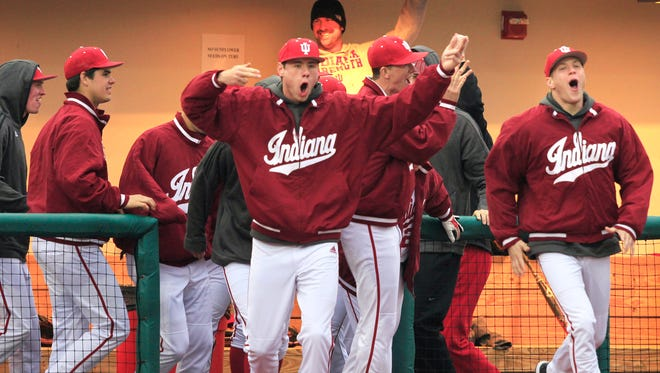FILE - IU baseball team rushes out of the dugout onto the field to celebrate with teammates after the last out of the Hoosiers' 9-3 victory over Louisville at Bart Kaufman Field in Bloomington on March 19, 2014.