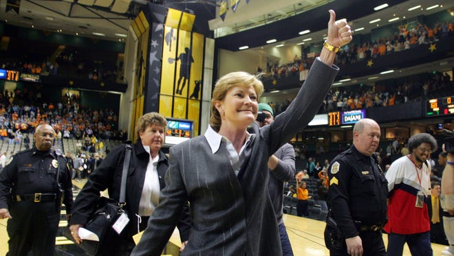 Lady Vols Coach Pat Summitt leaves the court after her 900th win in January 2006 at Vanderbilt.