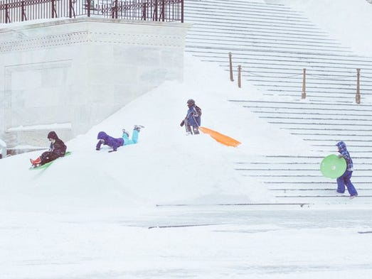 Children sled on the Capitol's steps in Washington,