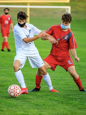 Josh Murray, left, and Silver Lake's Michael Day battle for control of the ball.