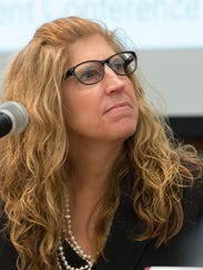 Dr. Karyl Rattay, along with local leaders, discuss