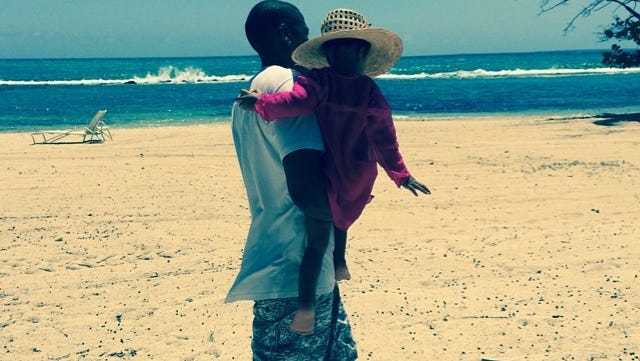 Beyonce shares photo of Jay Z holding Blue Ivy.