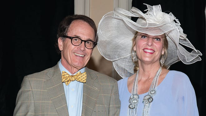 "Carl Barker and his wife, Melanie Halvorson Barker, were named the ""best dressed couple"" at the Kentucky Derby Benefit for Hospice of Montgomery (Courtesy of Patricia White Photography)"