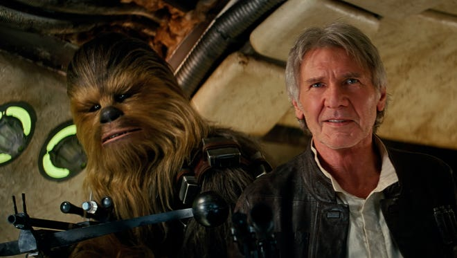 "Chewbacca (Peter Mayhew) and Han Solo (Harrison Ford) return in a galaxy far, far away in ""Star Wars: The Force Awakens."""