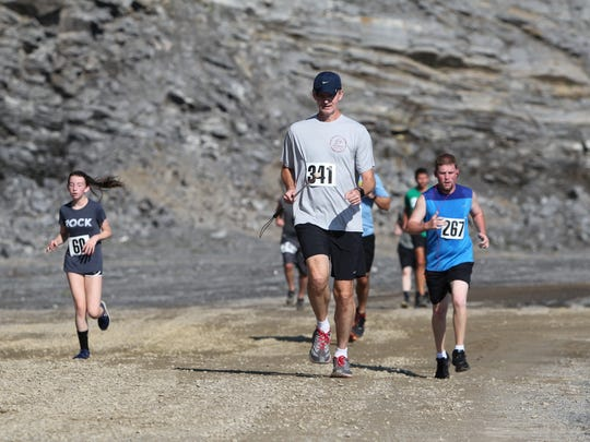 Ed McDaniel makes his way through the quarry in the Rock the Quarry 5K Trail Challenge at Grove Stone & Sand in September.