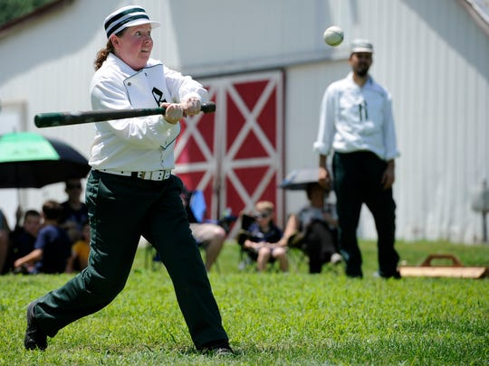 "Brigid ""Ginger"" Day of the Travellers Club of Brentwood takes a swing at a pitch during their game against the Highland Rim Distillers at Ravenwood Mansion Sunday, July 10, 2016, in Brentwood, Tenn."