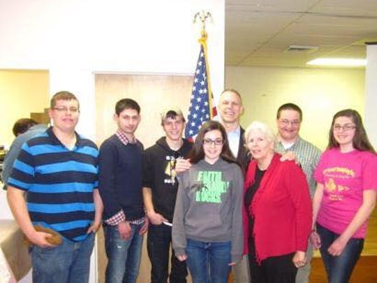 The Adams County Young Conservatives pose with Rep.
