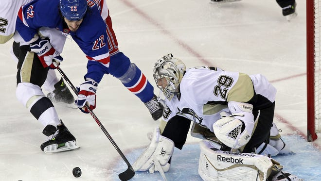 Pittsburgh Penguins goalie Marc-Andre Fleury (29) makes a save against New York Rangers center Brian Boyle (22) during the third period in game four of the second round of the 2014 Stanley Cup Playoffs at Madison Square Garden. The Penguins defeated the Rangers 4 - 2 to take a 2 - 1 series lead.