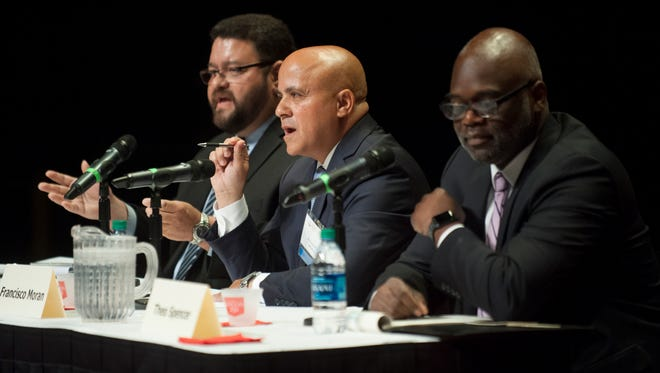 The Democratic candidates for Camden mayor, from left, Raymond Lamboy, Frank Moran, and Theo Spencer take part in a debate, sponsored by the Chamber of Commerce of Southern New Jersey, and held at Rutgers University in Camden on Thursday.  05.22.17
