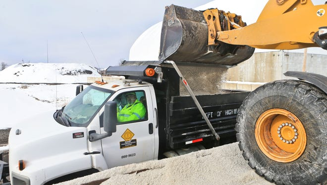 David Danner of Henry County waits for his salt truck to get filled by loader Jesse Schenk at the Kentucky Department of Highways District 5 branch Thursday morning.   Jan. 21, 2016