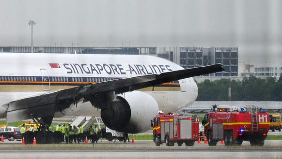 Cause of dramatic Singapore Air 777 fire could take months ...