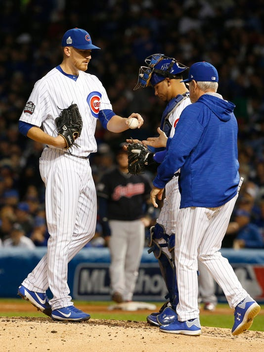 Chicago Cubs manager Joe Maddon, right, takes the ball from relief pitcher Mike Montgomery during the sixth inning of Game 4 of the Major League Baseball World Series against the Cleveland Indians, Saturday, Oct. 29, 2016, in Chicago. (AP Photo/Nam Y. Huh)