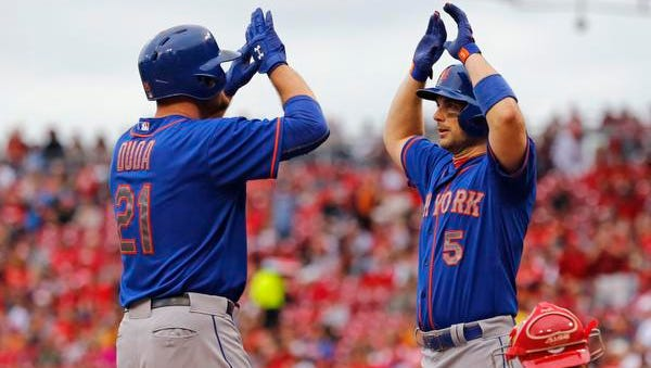 New York Mets' Lucas Duda, left, celebrates with David Wright after hitting a grand slam in the first inning of a baseball game against the Cincinnati Reds on Saturday.