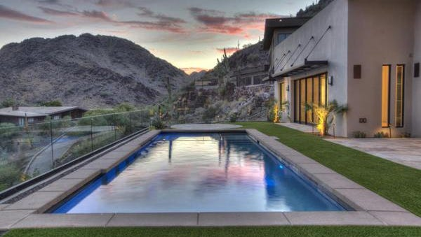The pool and mountain views of Chandler Jones', linebacker for the Arizona Cardinals, new home. Jones purchased this custom home in Paradise Valley's Clearwater Hills community. The 5,124-square-foot contemporary-style home has three bedrooms and five bathrooms, with beautiful views of downtown Phoenix