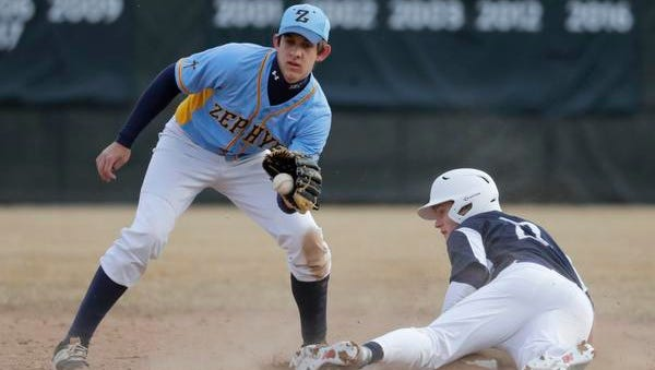St. Mary Catholic High School's Christian Jack, left, is late on the tag against Xavier High School's Chris VandenHeuvel during their baseball game Tuesday, March 27, 2018, at St. Mary Catholic High School in Fox Crossing, Wis.