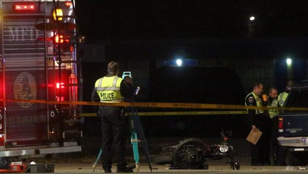 The Murfreesboro Police Department work a fatality involving a motorcycle on South Church Sunday evening, Dec. 7, 2014.