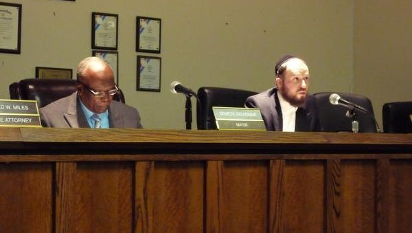 Spring Valley village Trustee Asher Grossman spoke during Friday's special meeting on the villageÕs insurance renewal. Mayor Demeza Delhomme is at his left.