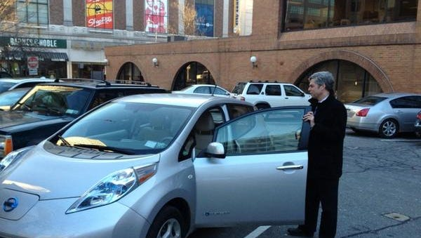 White Plains Mayor Tom Roach with his Nissan Leaf electric car in a 2013 photo.