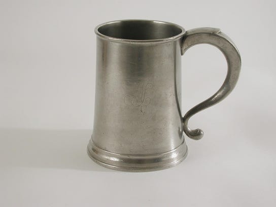 Quart mug  made by Thomas Danforth II in the late 1700s,