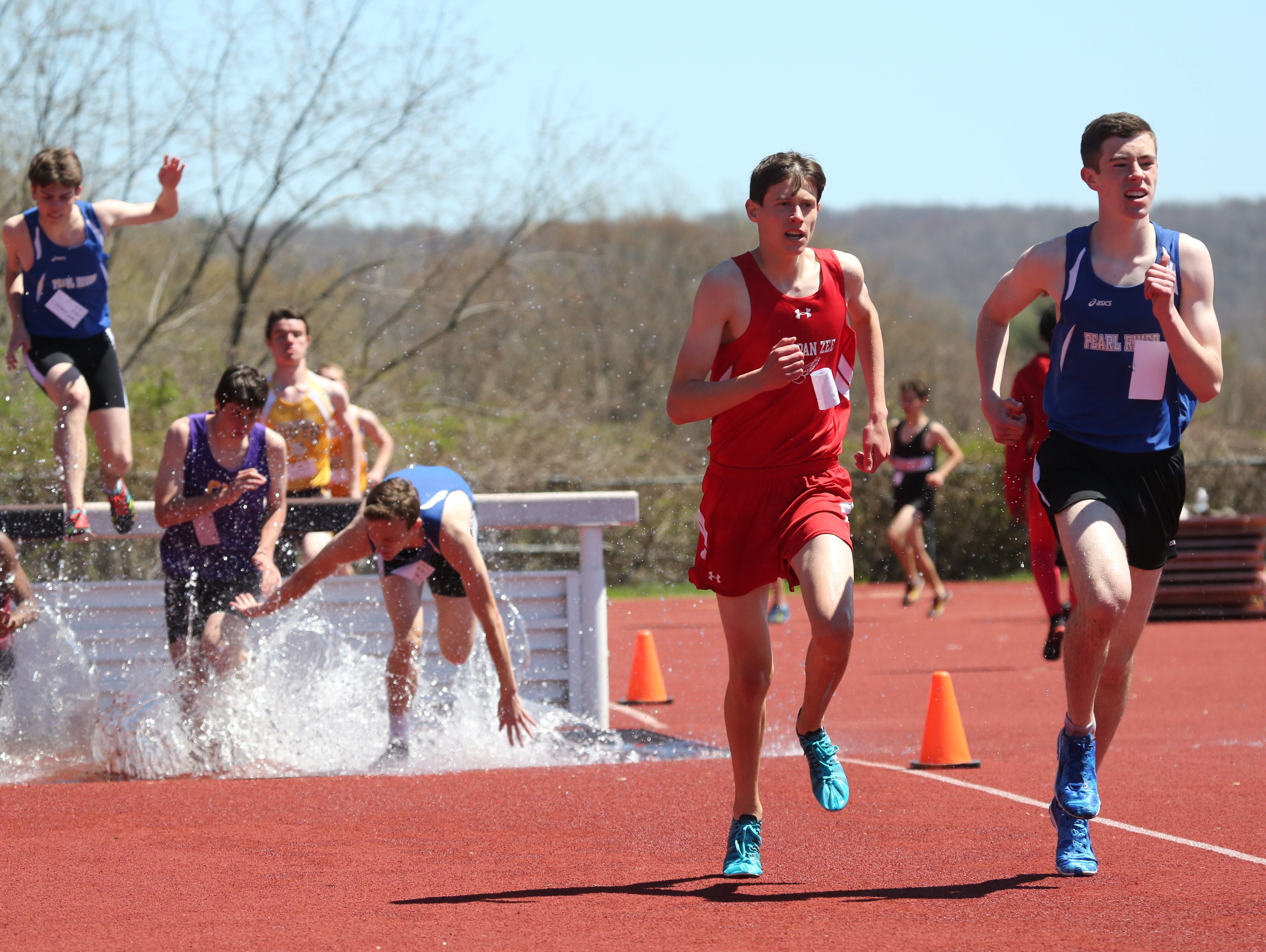 Tappan Zee's Brendan Hehir, second from right, competes in the boys 2000 meter steeplechase during the Clarkstown South Gold Rush Track Invitational at the school in West Nyack, April 25, 2015. Hehir won the race.
