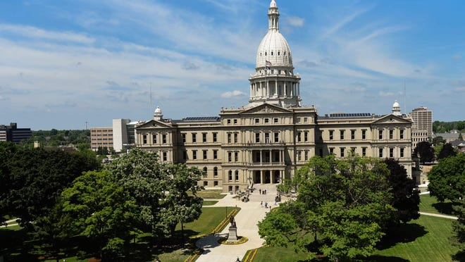 """""""Black Lives Matter"""" was painted on Capitol Avenue in front of the Michigan State Capitol Friday, June 19, 2020.  The project was spearheaded by Ferrin Mitchell, a Lansing native, along with help from other volunteers.Blm Muralmd7 0705"""