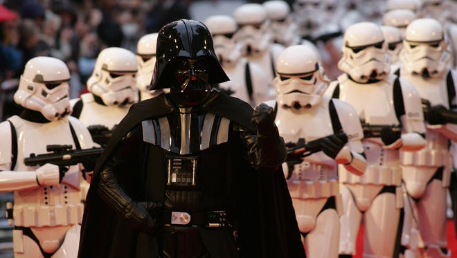 British fans dressed as Star Wars Imperial Storm troopers and Darth Vader march up to the British premiere of the film Star Wars Episode III The Revenge of the Sith, in London, Monday May 16, 2005.