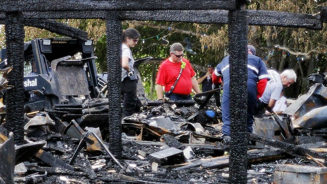 Fire officials search through rubble of a Fort Myers Beach duplex on Estero Boulevard that exploded May 24.