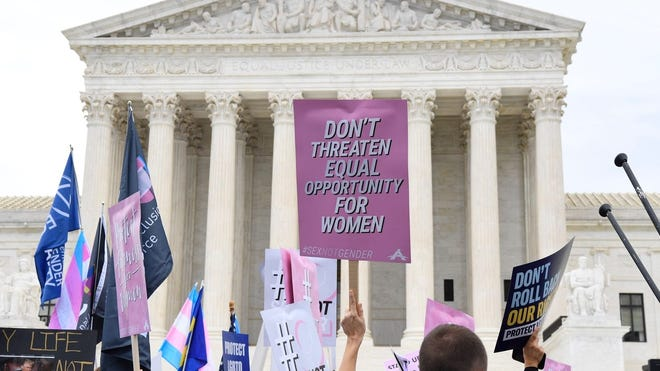 Demonstrators gathered in front of the Supreme Court on Oct. 8, 2019, as the justices heard three challenges from New York, Michigan and George involving workers who claimed they were fired because they were gay or transgender.