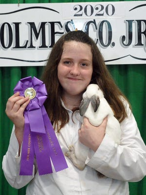Jarah Gurley won the rabbit supreme showmanship award and was the junior showmanship grand champion Wednesday in the Holmes County Fair Rabbit Show.