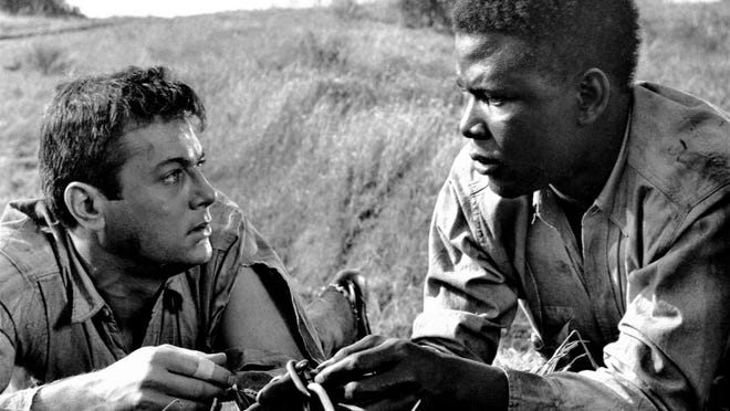 "Tony Curtis and Sidney Poitier in ""The Defiant Ones"" (1958)."