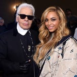 Chanel artistic director Karl Lagerfeld and Beyonce attend the Chanel Paris-Salzburg Metiers d'Art Collection show March 31 in New York.