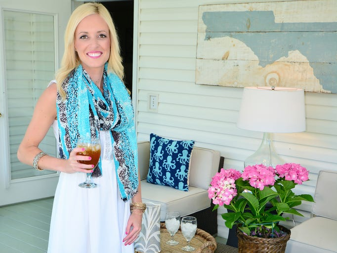 The back porch of the Winchester home is a place they enjoy entertaining company. The sea life printed pillows add a fun pop of color in this neutral space. These fun pillows also make an appearance in other rooms of the home.For more stories and photos, see the July issue of Pensacola Bella Magazine, and go to www.BellaMagazine.com. <o:p></o:p>
