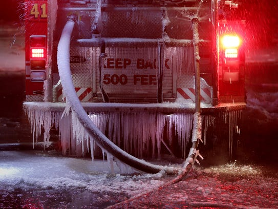 As Detroit firefighters contain a two-alarm fire at