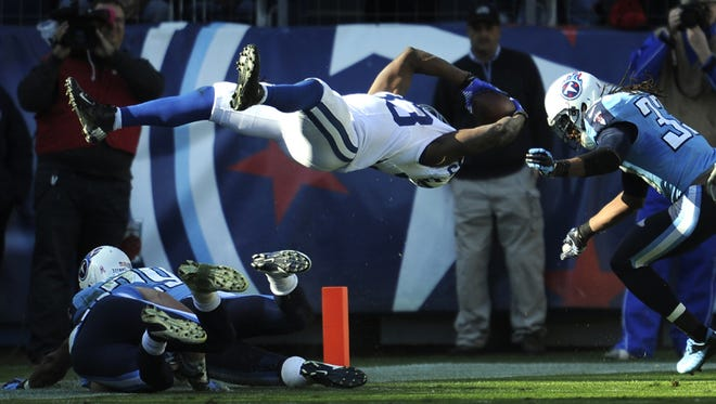 Colts running back Vick Ballard (33) dives into the end zone past Titans free safety Michael Griffin (33) to score the game-winning touchdown in overtime as the Colts win 19-13 at LP Field on Sunday, Oct. 28, 2012 in Nashville, Tenn.