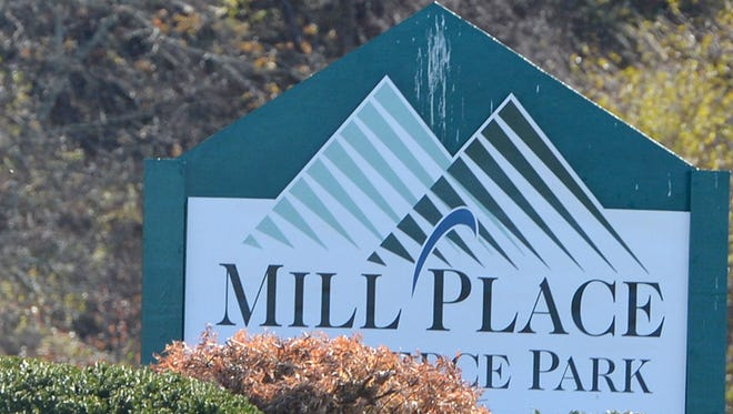 A sign marks the entrance to Mill Place Commerce Park in Verona.