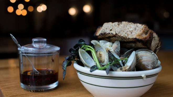 Steamed clams with ginger, garlic, watercress and a side of chile oil from Hungry Pigeon in Philadelphia.
