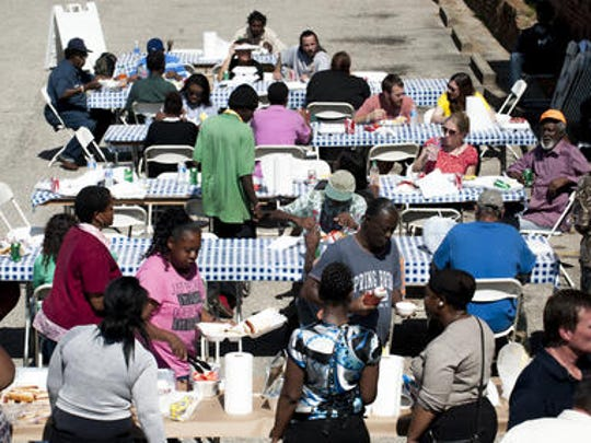 Hope Inspired Ministry holds a cookout for the homeless in downtown Montgomery on Thursday. Saturday is World Homeless Day.