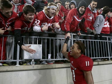 La Salle junior TreSean Smith celebrates with fans at Ohio Stadium after the Lancers' state championship win Dec. 4 in Columbus.