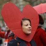 A climate activist demonstrates in Paris, Saturday during the COP21, the United Nations Climate Change Conference.
