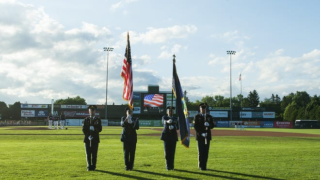 The color guard takes the field for the singing of the National Anthem during the baseball game between the Williamsport Crosscutters and the Vermont Lake Monsters at Centennial Field on Thursday night July 14, 2016 in Burlington.