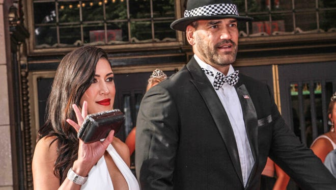 Former NBA player and Survivor star Scot Pollard and his wife Dawn Pollard arrive on the red carpet for the annual KeyBank 500 Festival Snakepit Ball celebrating the Indianapolis 500, held at the Indiana Roof Ballroom in Indianapolis on Saturday May 27, 2017.
