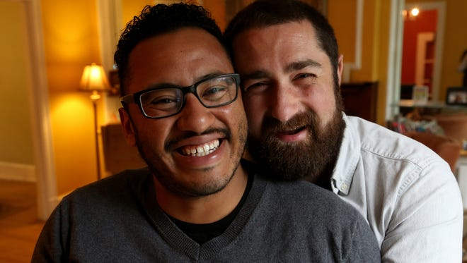 (L to R) Tom Molina-Duarte, 28 and husband Bryan Victor 30 in their Detroit, Michigan home on Saturday, October 3 2015. 