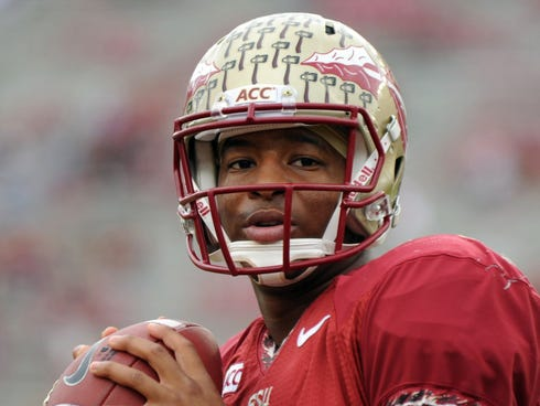Florida State quarterback Jameis Winston (5) warms up before the Seminoles' Nov. 23 game against Idaho at Doak Campbell Stadium.