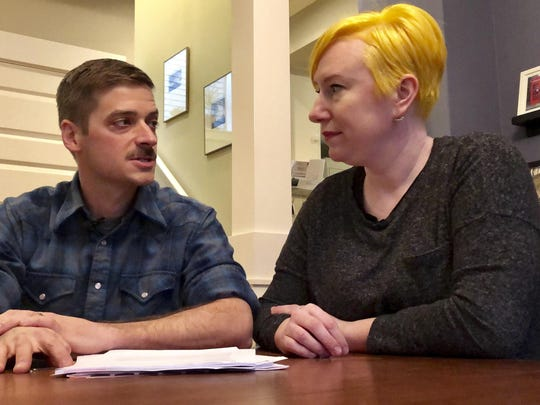 Husband and wife Andy Kraft and Amy Elias, of Portland, Oregon, talk during an interview about their 2018 tax paperwork in their Portland home on Feb. 18, 2019. The couple got a small refund last year but this year owe more than $10,000 in taxes under the new tax law.