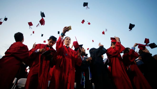 North Salem High graduating senior take part in commencement on Friday, June 10, 2016. Timothy J. Gonzalez/For the Statesman Journal